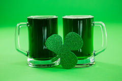 St Patricks Day two mugs of green beer with shamrock Royalty Free Stock Images