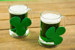 St Patricks Day two mugs of green beer with shamrock Stock Photos