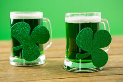 St Patricks Day two mugs of green beer with shamrock Stock Images
