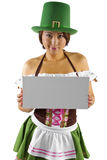 St Patricks Day Waitress. Young Asian female waitress dressed in costume for St Patrick's Day with a blank sign Royalty Free Stock Photo