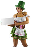 St Patricks Day Waitress. Young Asian female waitress dressed in costume for St Patrick's Day with a blank sign Royalty Free Stock Image