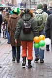 St. Patricks day walk. St. Patricks day -young man and girls in clothes of celebratory color easy walk on city Stock Photo