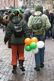 St. Patricks day walk. St. Patricks day -young man and girl in clothes of celebratory color easy walk on city Stock Photos
