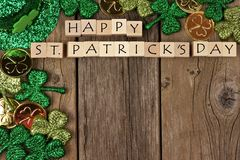 St Patricks Day wooden blocks with decor on rustic wood. Happy St Patricks Day wooden blocks with shamrocks decor on a rustic wood background Royalty Free Stock Image