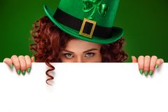 St patricks day. Young ginger Oktober fest woman leprechaun, wearing a traditional Bavarian dress, serving big beer. Half-length portrait of young redhead woman royalty free stock photos