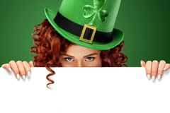 St Patricks Day. Young sexy ginger Oktoberfest waitress, wearing a traditional Bavarian dress, serving big beer mugs on. Half-length portrait of young sexy Royalty Free Stock Photos