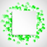 Shamrock background for Saint Patricks Day. St patricks paper plate with shamrock. Lucky trefoil confetti. Glitter frame of clover leaves. Template for voucher Royalty Free Stock Photography