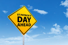 St Patrik's Day Ahead. Road sign on blue sky Stock Images