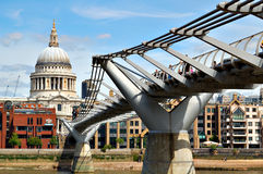 St Paul Cathedral and the Millennium Bridge. A view of St Paul Cathedral including the Millennium Bridge Royalty Free Stock Photos