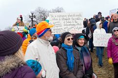 Crowd at Rally Holds Signs as Students Arrive. St. Paul, Minnesota, USA – MARCH 24, 2018: Protesters hold up signs and watch students' arrival during March Stock Photography