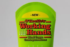O`Keefe`s Working Hands Hand Cream and Trademark Logo. ST. PAUL, MN/USA - FEBRUARY 16, 2019: O`Keefe`s Working Hands hand cream and trademark logo stock photo