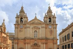 St Paul and Peter cathedral in Mdina, Malta. Catholic church under cloudy sky background. Ideal destination for pray and tourism Stock Photography