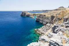 St paul's bay and rocks at Lindos, Rhodes, Greece Royalty Free Stock Photo