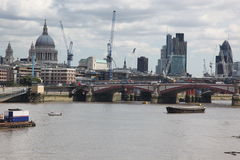 St. Paul`s Cathedral, City and Thames river in London Stock Photography