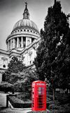St Paul's Cathedral dome and red telephone booth. London, the UK. Stock Photography