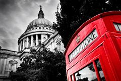 St Paul's Cathedral dome and red telephone booth. London, the UK. St Paul's Cathedral dome and red telephone booth. Symbols of London, the UK. Black and white Royalty Free Stock Images