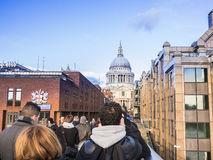 St Paul's Cathedral dome viewed from the Millennium Bridge, London, on a sunny winter afternoon. Royalty Free Stock Photos