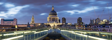 St. Paul's Cathedral, London. Panoramic picture of St Paul's Cathedral and Millennium Bridge at night royalty free stock photos