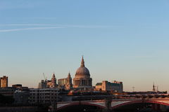 St. Pauls cathedral in London. St. Pauls cathedral and Millennium Bridge in London Royalty Free Stock Photography