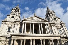 St Paul`s CatLondon frontal viewhedral. St Paul`s Cathedral London, frontal view, with its towers reaching the blue sky with clouds Stock Photo