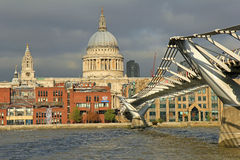St Pauls Cathedral, London. St Pauls Cathedral on the horizon in London, Millennium bridge Stock Images