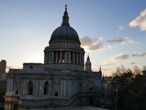 St. Pauls cathedral London. Sun setting behind St. Pauls cathedral Royalty Free Stock Photography