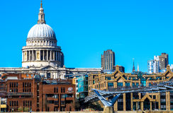 St Paul's Cathedral, the Millennium Bridge and City of London Sc. St Paul's Cathedral, City of London School and the Millennium Bridge with people walking on a stock photos