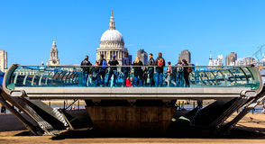 St Paul's Cathedral and the Millennium Bridge in London. London, England - April 20, 2016 - St Paul's Cathedral and one head of the Millennium Bridge with royalty free stock photography