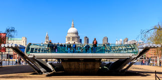 St Paul's Cathedral and the Millennium Bridge in London. London, England - April 20, 2016 - St Paul's Cathedral and one head of the Millennium Bridge with royalty free stock photo