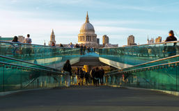 St Paul's Cathedral and the Millennium Bridge in London. London, England - April 20, 2016 - St Paul's Cathedral and Millennium Bridge with tourists and locals stock photo