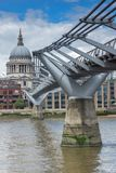 St. Paul`s Cathedral and Millennium bridge, London, England, Great Britain. LONDON, ENGLAND - JUNE 15 2016: St. Paul`s Cathedral and Millennium bridge, London Royalty Free Stock Images