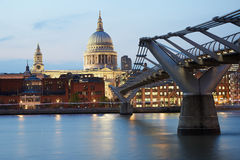 St Paul's cathedral and Millennium bridge in London, evening Royalty Free Stock Photography