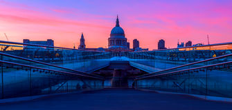 St Paul's Cathedral and the Millennium Bridge in London stock photos