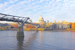 St. Paul's cathedral with the Millennium bridge in London UK Royalty Free Stock Photo