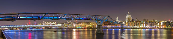 St Paul's Cathedral and the Millennium Bridge by night, London, UK royalty free stock images