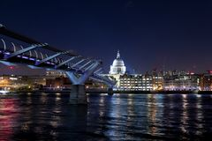 St Paul`s Cathedral and the Millennium Bridge at night Royalty Free Stock Images