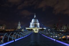 St Paul`s Cathedral and the Millennium Bridge at night Stock Photo