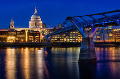 St Paul's Cathedral and the Millennium bridge. The Millennium Bridge, officially known as the London Millennium Footbridge, is a steel suspension bridge for Royalty Free Stock Photos