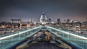 St. Paul's Cathedral & Millennium Bridge at twilight Stock Images