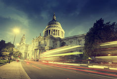 St Paul's Cathedral and moving Double Decker bus. London, UK Royalty Free Stock Photo