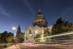 St Paul`s Cathedral, at night, with traffic trails of London buses Stock Photography