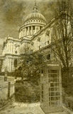 St. Paul's Cathedral and Red Telephone Box in London. Vintage Antigue Picture of St. Paul's Cathedral in London Royalty Free Stock Images