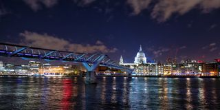 St Paul`s Cathedral and the Millennium Bridge at night royalty free stock photo