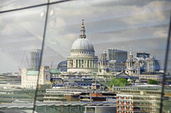 St Pauls Cathedral. An unusual view of St Pauls Cathedral in London reflected in the window of the OXO Tower opposite Royalty Free Stock Photo