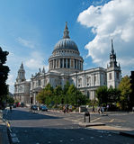 St Pauls Cathedral. A view of St Pauls Cathedral showing a typical road in London including traffic lights and a black cab Stock Photo