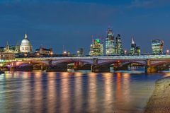 St Pauls cathedral, Blackfriars Bridge and the City. Of London at night royalty free stock photo