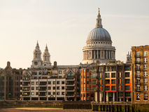 St Pauls Cathedral Church London England. Modern apartments and homes by river Thames with St Pauls Cathedral in London England at dusk as the sun is setting low Stock Image