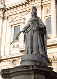 St Pauls Cathedral Church London England. Statue of Queen Anne with bird perched on crown in St Pauls Cathedral in London England at dusk as the sun is setting Royalty Free Stock Photos