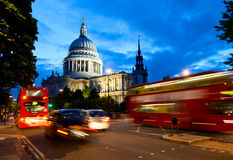 St Pauls Cathedral at dusk. London cityscape with St Paul's Cathedral and moving Double Decker buses at night Royalty Free Stock Image