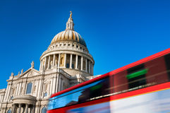St. Pauls Cathedral, London. St. Pauls cathedral with motion blured double decker bus Royalty Free Stock Image